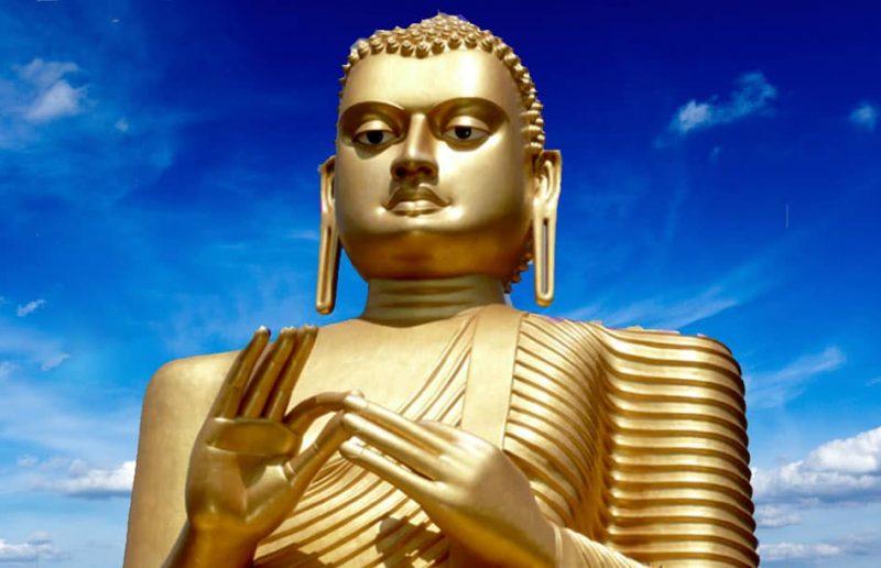 golden buddha statue dambulla